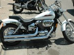 Honda Shadow motorcycle, brand-new, with straight pipes, by Flickr user Jess_Anderson