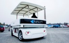 Driverless Electric Shuttle Bus Carries Racetrack Visitors (Video)