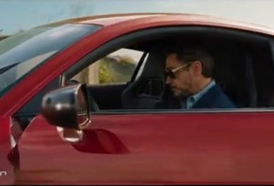 Iron Man Tony Stark (Robert Downey Jr.) in the Audi R8 e-tron