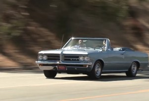Jay Leno checks out the 1964 Pontiac GTO convertible