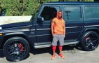 Comedian Kevin Hart poses with his Mercedes-AMG G65