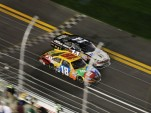 Kyle Busch leads Tony Stewart to the checkers - NASCAR photo