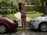 Kyle with his family Toyota Prius and the new 2010 Honda Insight he drives