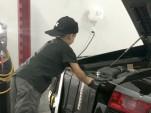 5-year old changes oil on Lamborghini Gallardo