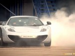 Lewis Hamilton uses a McLaren MP4-12C to sign his name