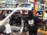 Lithium-ion battery pack installation in 2012 Ford Focus Electric at Wayne Assembly Plant