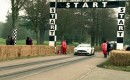 Lord March pilots the Aston Martin Vanquish up Goodwood Hill
