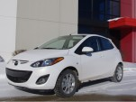 Mazda2: Kissed Nelson's Swag Leg chair?