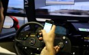 Mazdaspeed Motorsports driver Connor De Phillippi stacks a virtual race car while texting