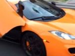 McLaren 12C with windshield smashed by skateboarder