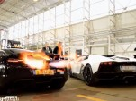 McLaren MP4-12C and Lamborghini Aventador flame battle screencap.