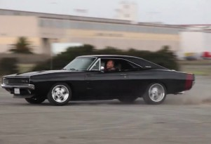 Mike Musto warms the tires on Mr. Angry, his 1968 Dodge Charger