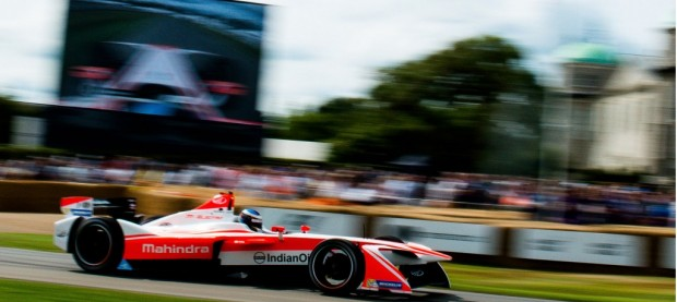 Nick Heidfeld in a Mahindra M4Electric Formula E race car at the 2017 Goodwood Festival of Speed