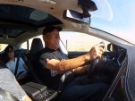 Nobuhiro 'Monster' Tajima, behind the wheel of the Tesla Model S