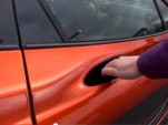 Opening the door of the McLaren P1