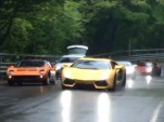 Over 100 Lamborghinis, in the rain, around a hairpin turn