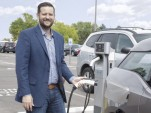 Pastor Jonathan Wiggins recharges BMW i3 electric car in Resurrection Fellowship Church parking lot