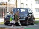 Pedestrians: Small children walking across an intersection