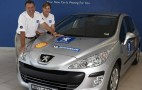 Peugeot 308 HDi breaks two Guinness world records