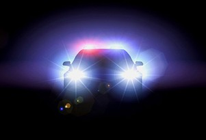 Police car with headlights on