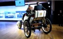 Porsche's re-created 1900 Semper Vivus hybrid drives across the floor at media event, April 2011