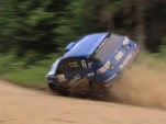 Rally driver rolls car, comes back to win anyway