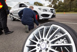 Replica wheel showing major damage after pothole test