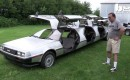 Rich Weissensel stands beside his custom DeLorean limo