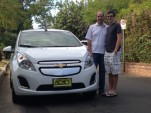 Rick and Alex Prell with new 2014 Chevrolet Spark EV, Studio City, CA