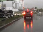 Russian Camaro driver gets it wrong in the rain, ends up on his side