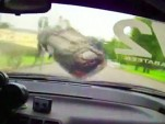 Russian race car somersaults after contact with low wall