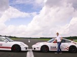 Sabine Schmitz and a pair of Porsche 911 GT3s