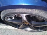 Scuffed wheel of a Ferrari FF damaged by Journalist