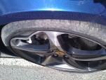 Scuffed wheel of a Ferrari FF damaged by Journalist