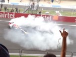 Sebastian Vettel does victory donuts after the 2013 Indian Grand Prix
