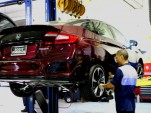 Service technician working on Honda Clarity Fuel Cell at dealership