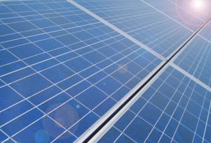Car dealer tries to install solar, town-owned utility limits power it can generate