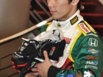 Takuma Sato with driver gloves collected for tsunami relief - Anne Proffit photo
