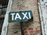 Taxi sign in Trzcianka, Poland (via Wikimedia)