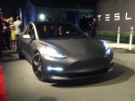 Automakers 'not even trying' to sell electric cars, Tesla says