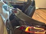 Tesla Model S electric car used as reception desk, Draper University Hero City [via Steve Jurvetson]