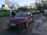 Tesla Model S inspection for seat-belt anchor at Supercharger, Nov 2015  [Bjørn Nyland, YouTube]
