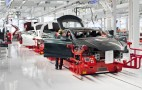 Tesla now building 2,000 electric cars a week, it says