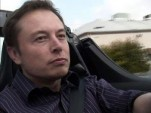 Tesla Motors CEO Elon Musk at the wheel of a Tesla Roadster