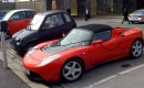 Tesla Roadster, Reva i, & Ford Th!nk electric cars parked at charging station in Oslo, Norway