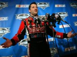 Tony Stewart's engulfed by microphones - NASCAR photo