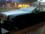 Topless Rolls-Royce Phantom Drophead Coupe in downpour