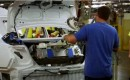 Nickel-metal-hydride hybrid battery pack being installed in trunk of new 2012 Toyota Camry Hybrid