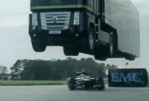 Truck jumping a Lotus Formula One car