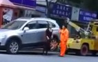 Video: Woman Having Car Towed Isn't About To Deal With Tow Truck Driver